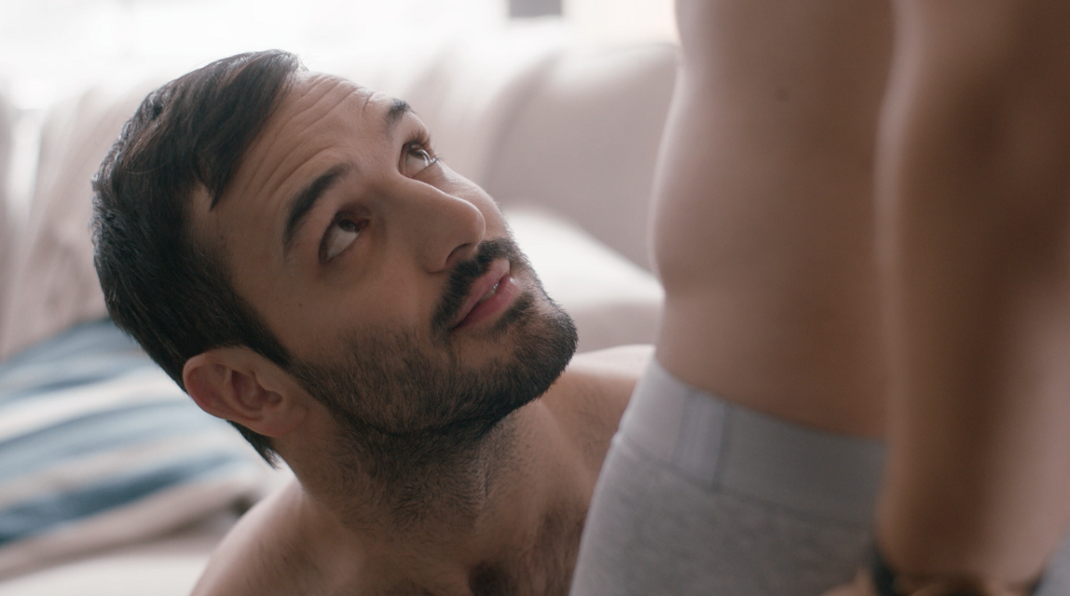 Still from the new gay series Interested In - Now Available on Dekkoo!